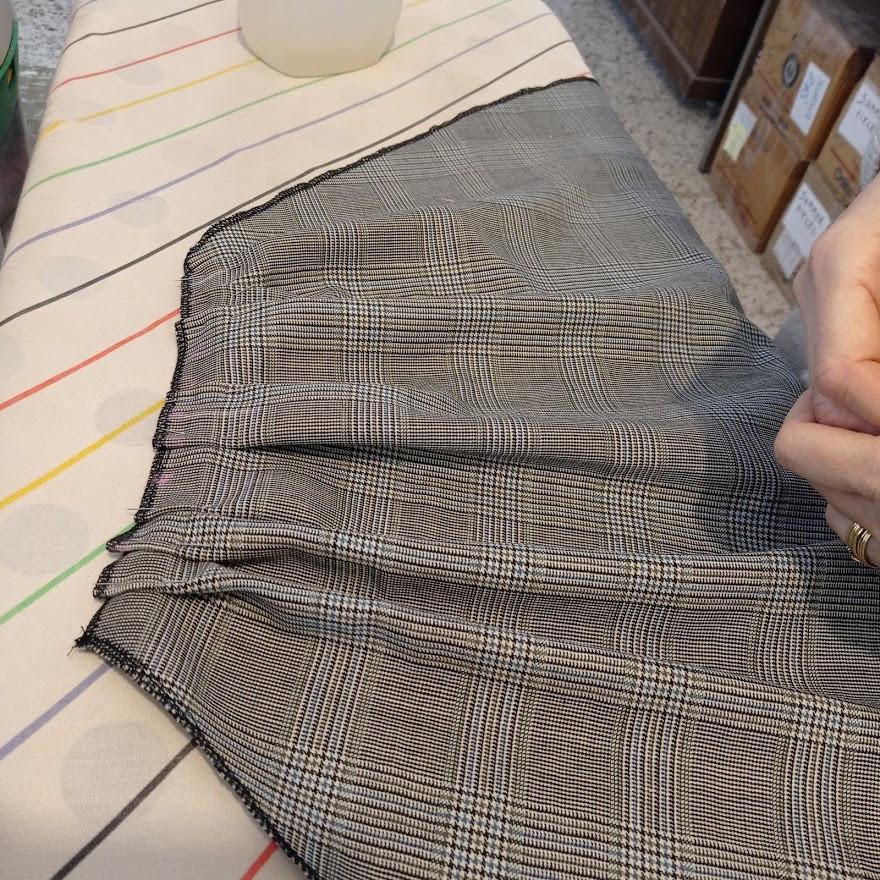 Pinning and ironing the pleats