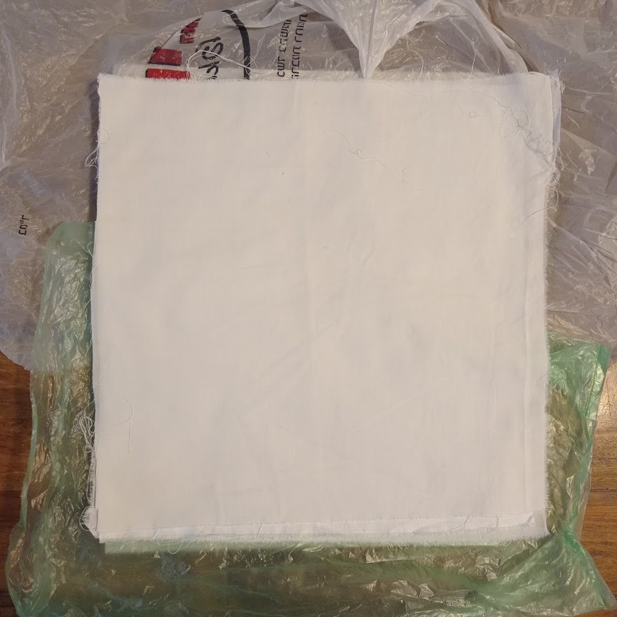 Cotton sheeting on a layer of plastic