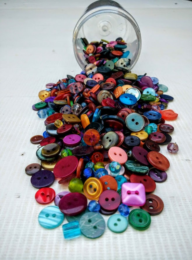 Bottle of buttons and beads