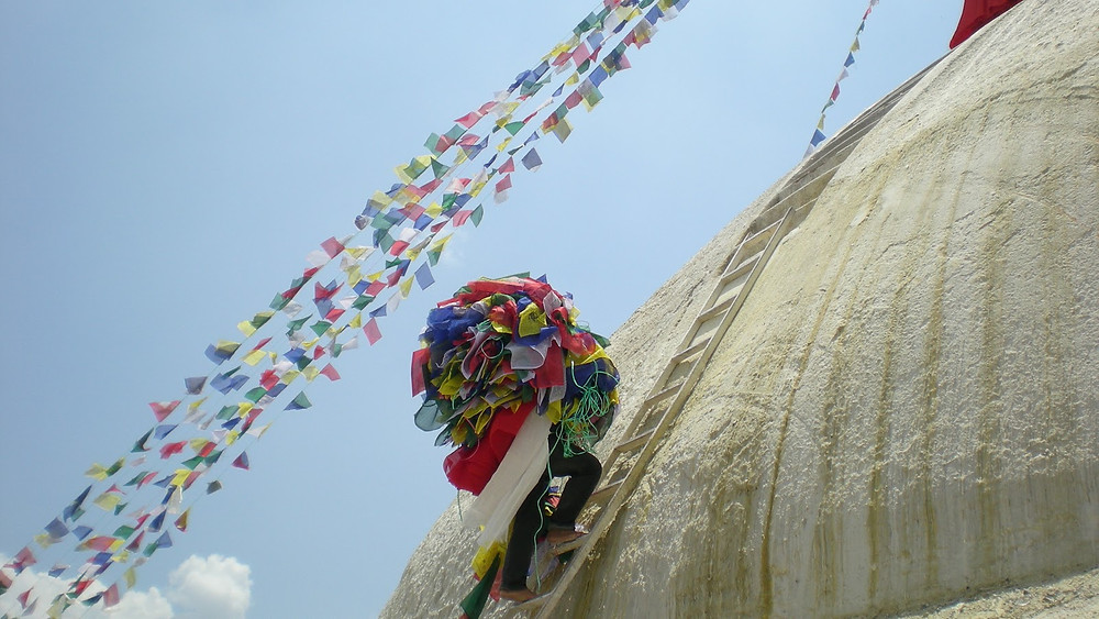 Kathmandu - Bouda Stupa. Buddhist full moon in April, sponsorship of prayer flags