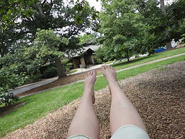 My bare feet taken while swinging in a park.