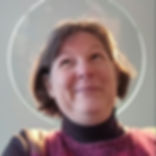 """Me with a """"halo"""" (the rim of glass hanging light) with an amused expression."""