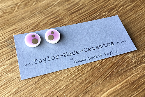 Round pink and gold decorated earrings.