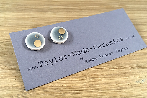 Round grey and gold decorated earrings.