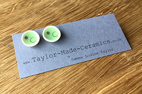 Ceramic Green Gold decorated dish shaped earrings.