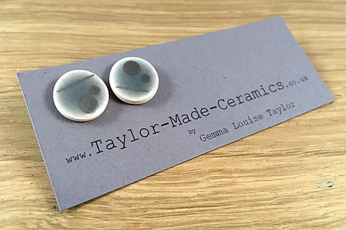 Round large blue/grey and silver decorated earrings.