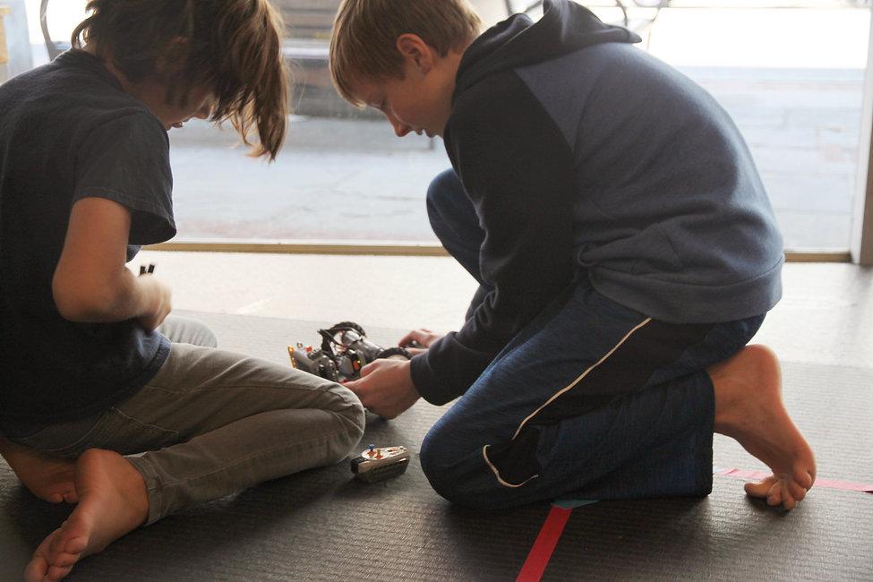 1.Boys building Floor Nok Bots.jpg