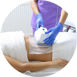 Woman receiving cryolipolysis treatment on stomach area