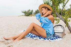 stylish-beautiful-smiling-woman-sitting-