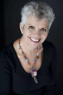 Branding Headshots corporate portrait of Deb Hocking, a life coach, smiling, feeling great and looking confident.