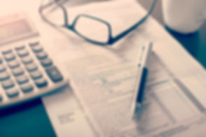 Individual income tax return form, glass