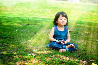 Little asian girl practicing mindfulness