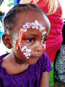 Orange and Red Flower Face Paint