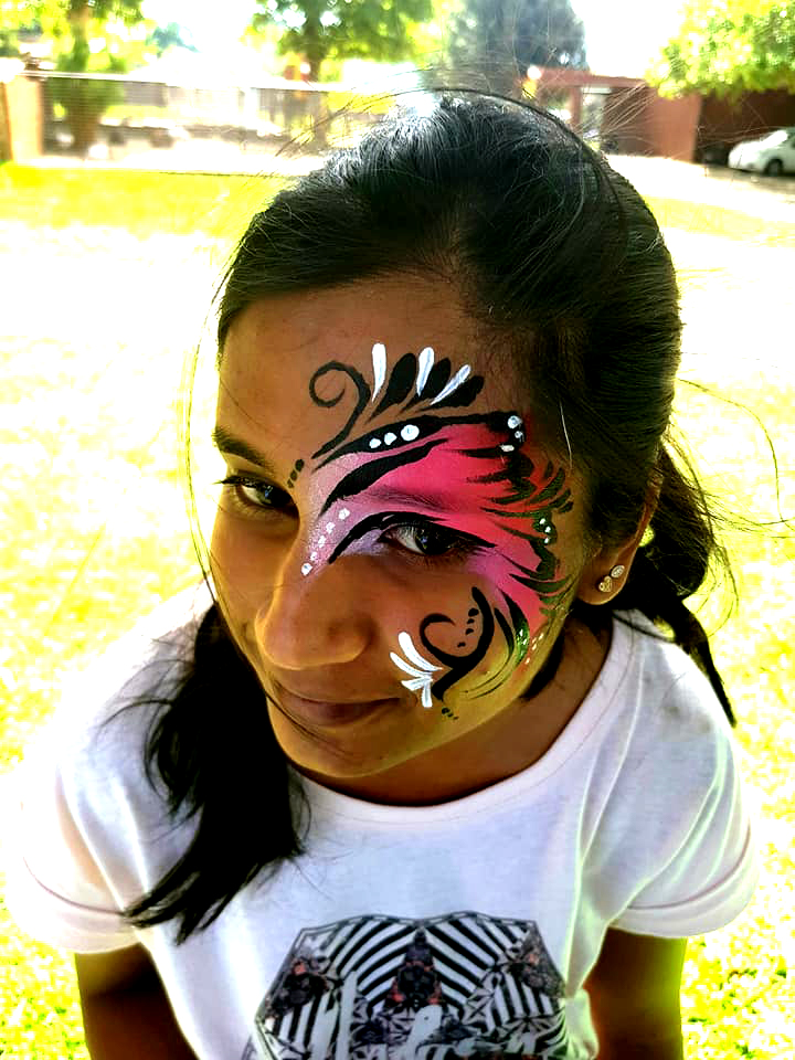 Girls Swirl Face Paint Eye Design