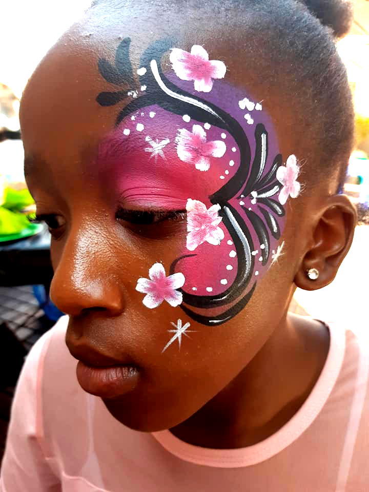 Pink Flowery Swirl Face Paint Design
