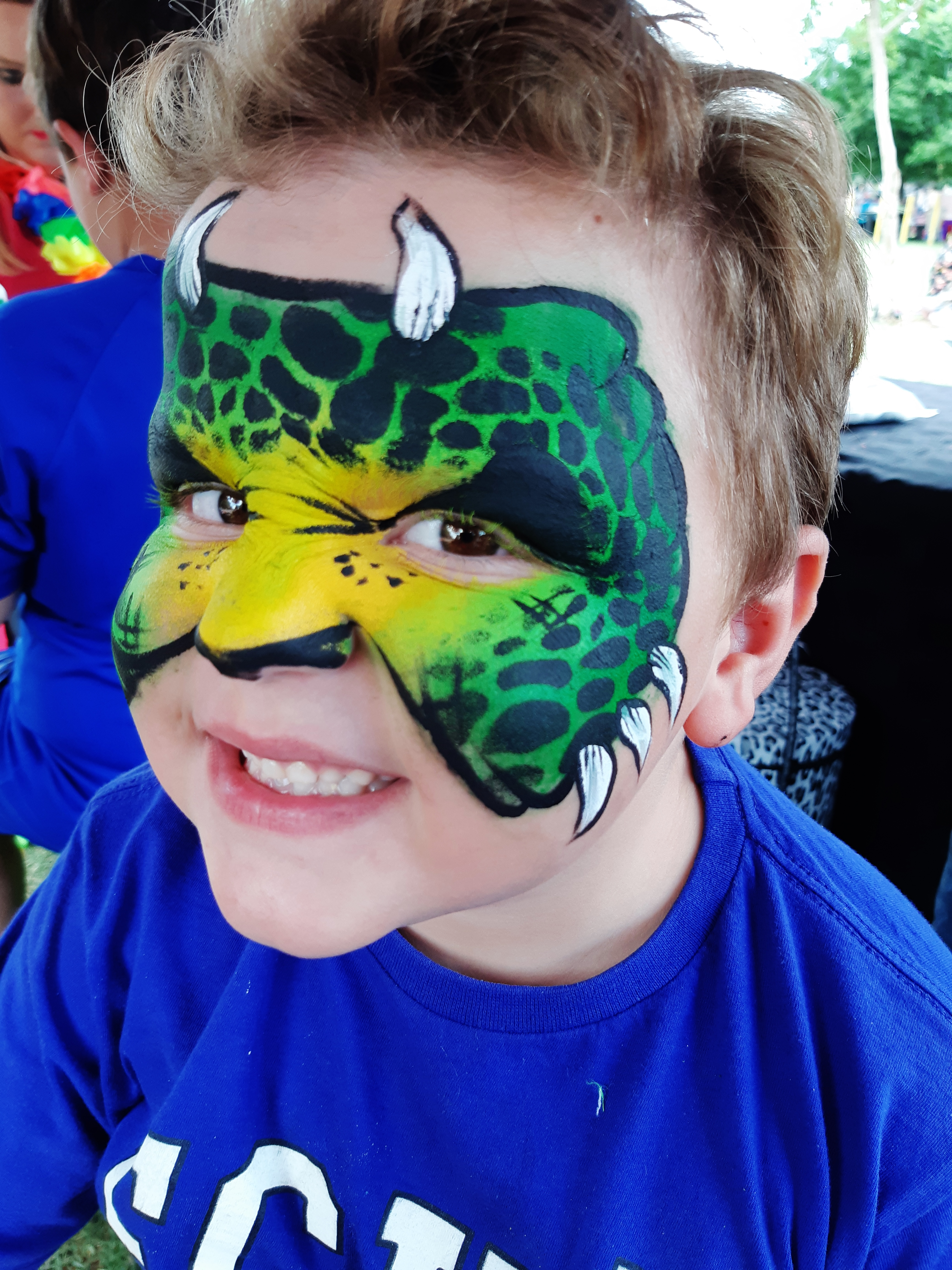 Green Dinosaur Face Paint Design