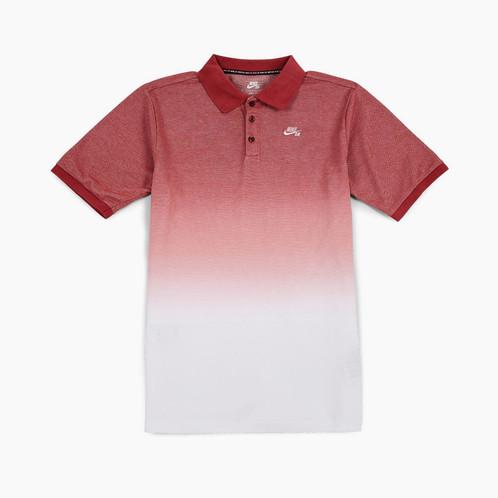 e3ec7ca9f Nike SB Dri-FIT Dip Dye polo shirt. Tonal Nike SB logo embroidery at left  chest. Woven Nike SB label with seaming at back. Underarm vents.