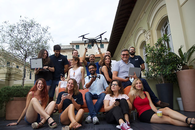 The Wesii team outside the office with drones