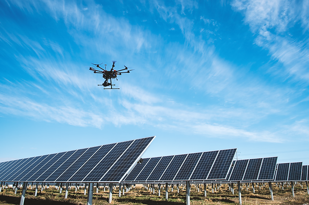 A drone performing an aerial inspection of a PV plant