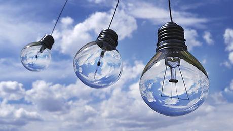 A string of lightbulbs against a blue sky