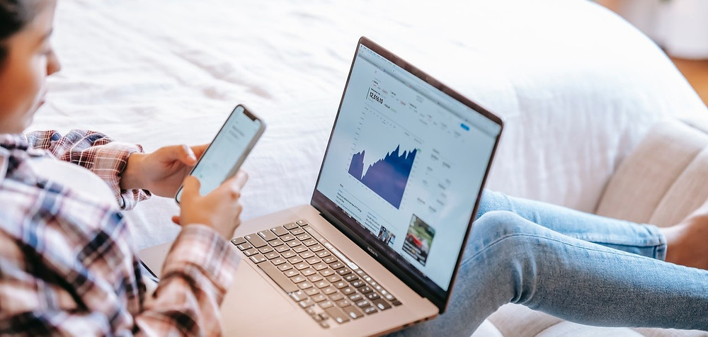 A businesswoman looking at commercial finance data online