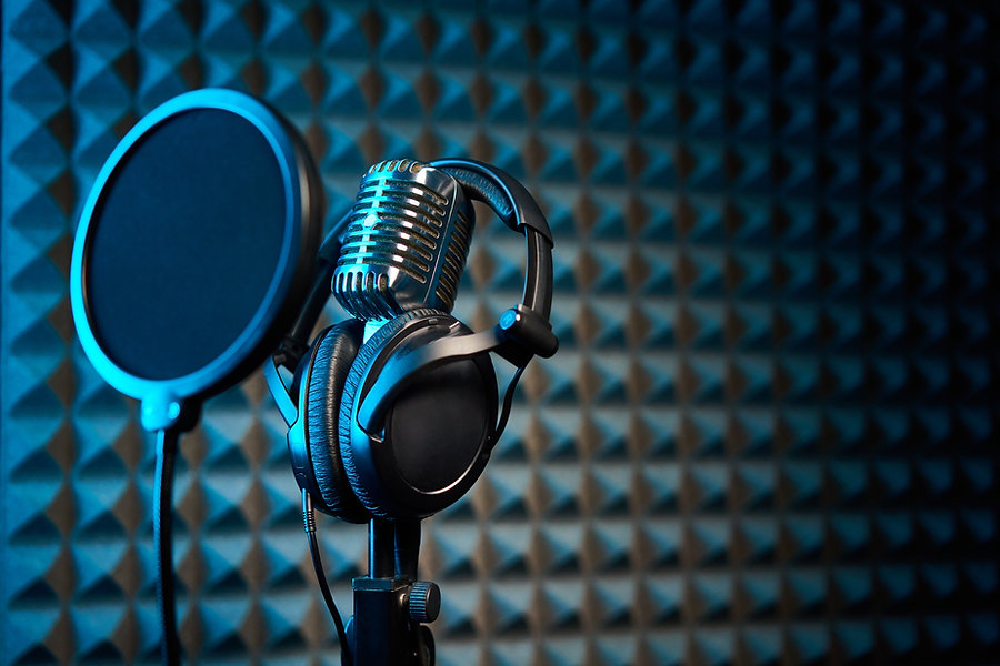 Out of the Comfort Zone podcast – microphone, headphones, recording studio