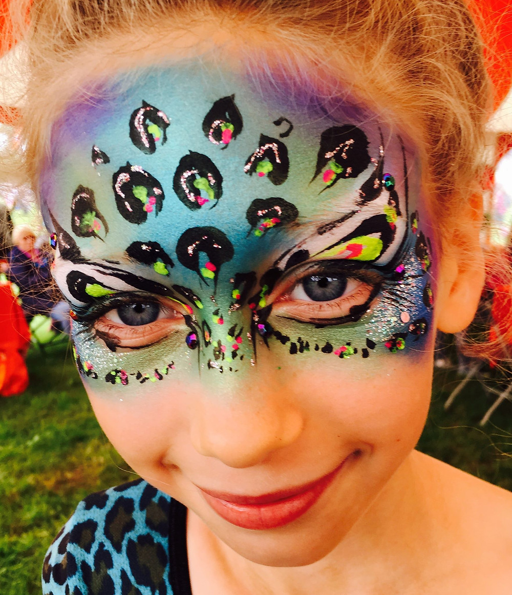 Rainbow leopard face paint at Camp Bestival