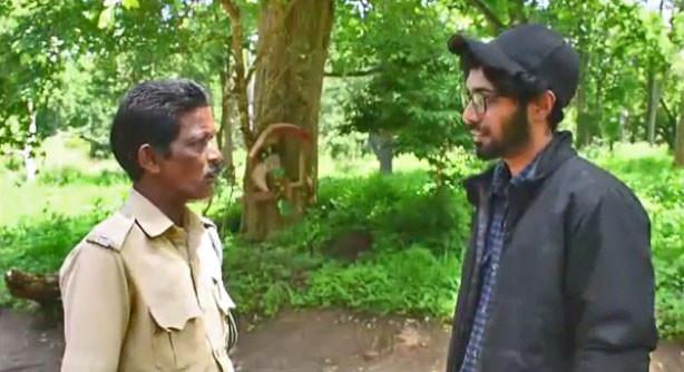 Researcher Dencin interviews forest guard Ashokan