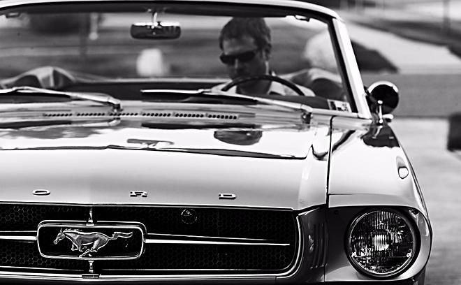 Ben Shearman in a Ford Mustang