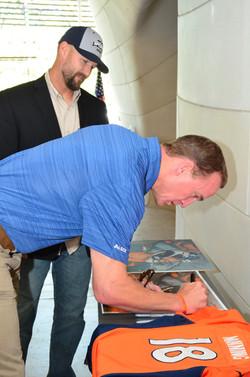 Peyton signing my painting