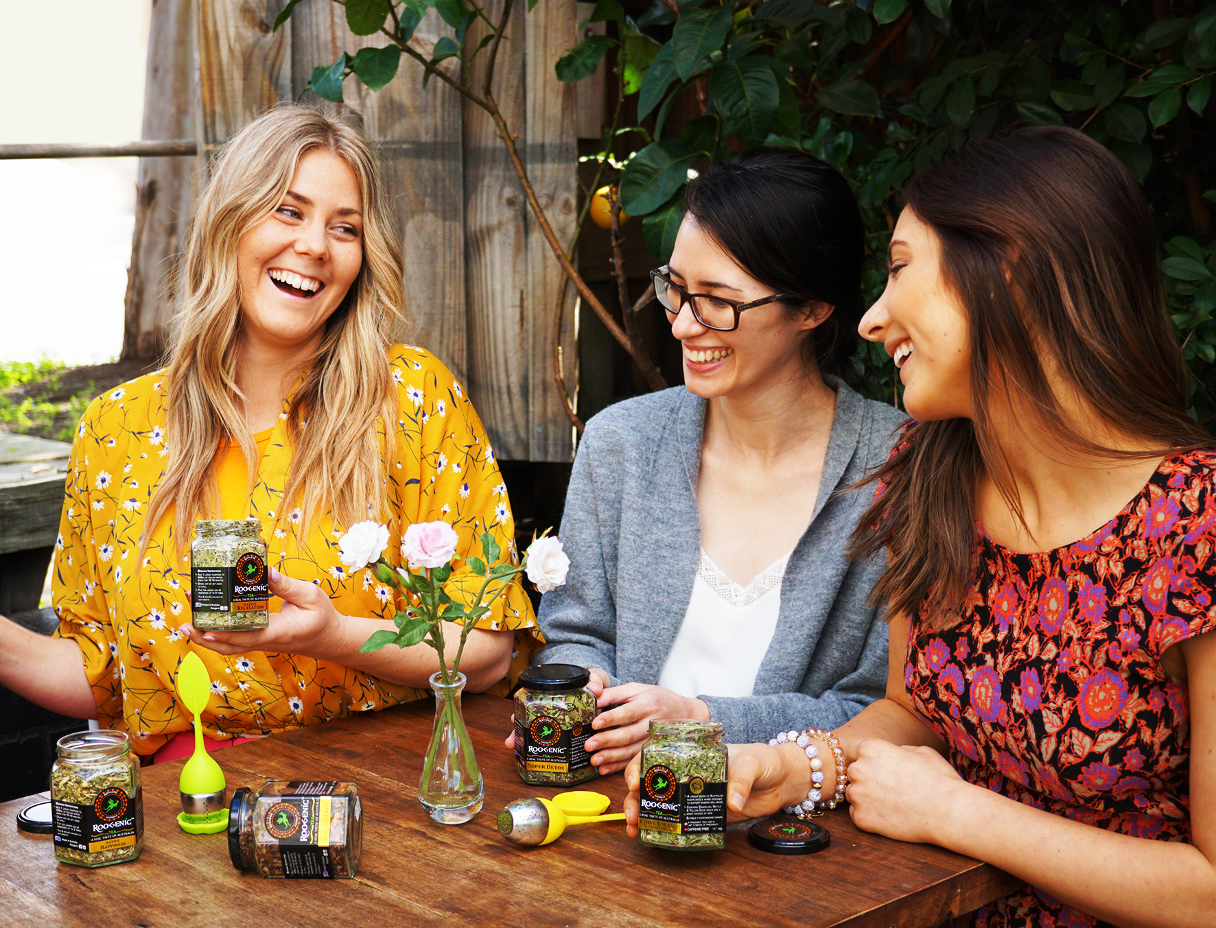 Native Happiness - 3 Females at a Table.