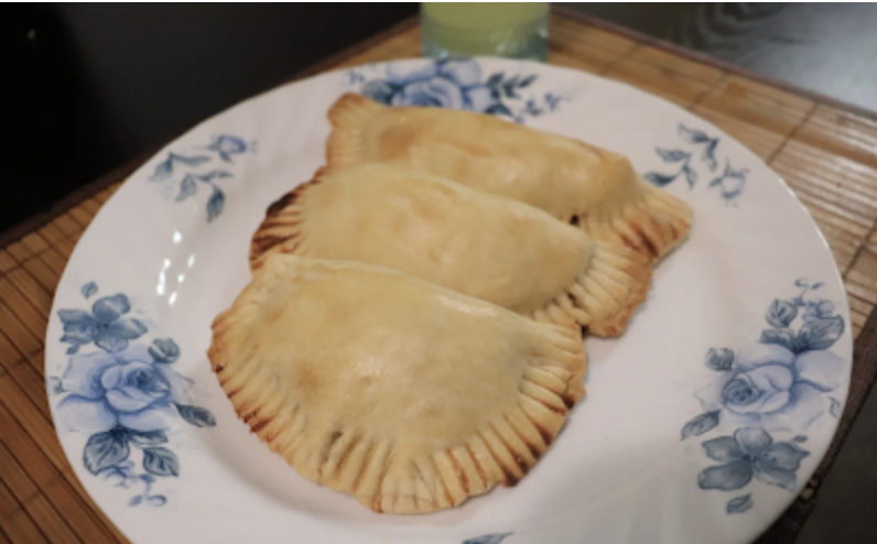 Three meat pies on a plate