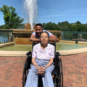 Kwei Quartey and his mother at a park