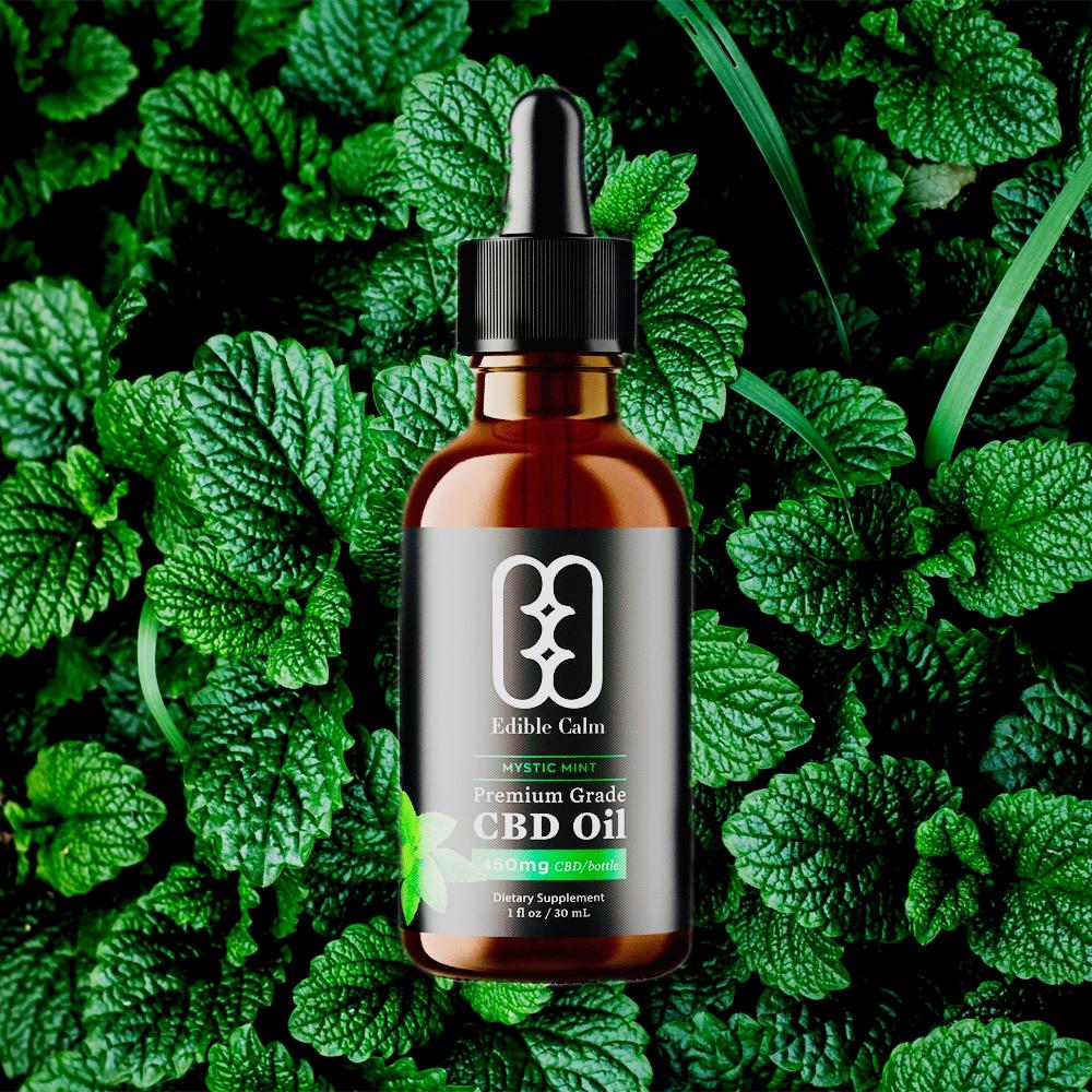 A bottle with dropper of Edible Calm Mystic Mint cannabidiol oil