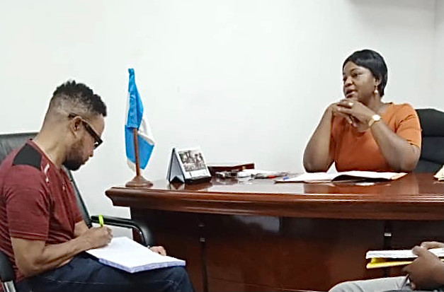 Kwei Quartey taking notes in the office of Benin Zonal Commander Chidiebere Oruruo-Ufudu