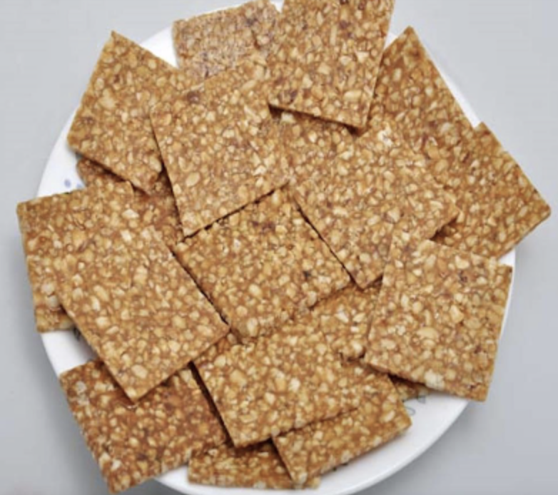 Flat pieces of peanut brittle made with sugar and butter