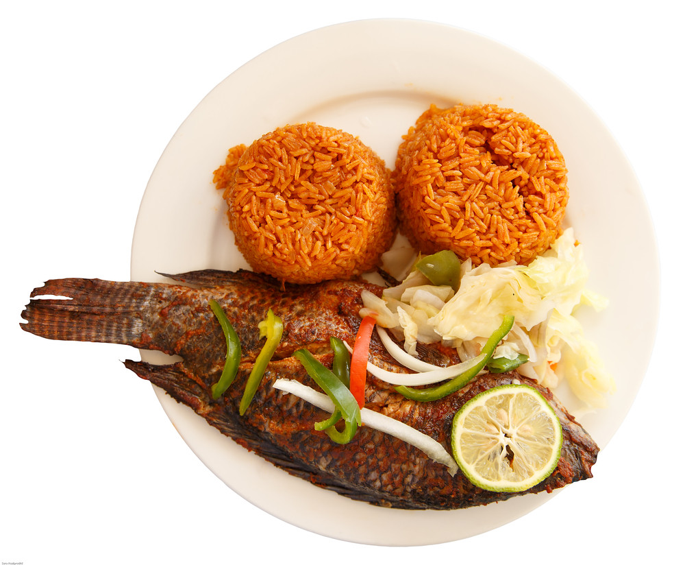 Jollof rice in two neat collections with grilled tilapia