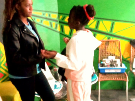 At Cape Town tv, AYI's Project Leader Natasha coaching the10 yr-old interviewee.