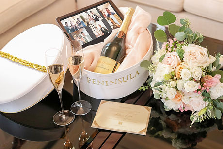 Page delivery of a Bespoke Page Hat Hamper including an invitation card, Champagne, flutes