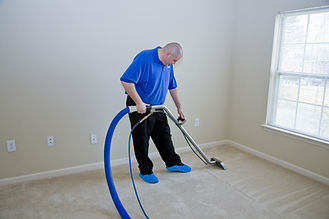 Man cleaning carpet with commercial clea
