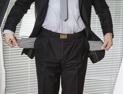 Businessman in suit with empty pockets