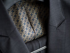 Close up of dark grey jacket with colorf