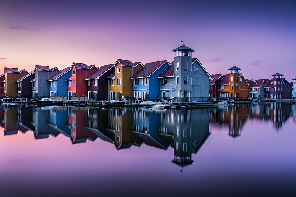 Perfect reflection at twilight at reitdiephaven in the Netherlands