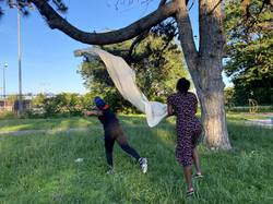 Simone and Samira Trying to hang the canvas from the tree.