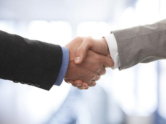Two business men shaking hands.jpg