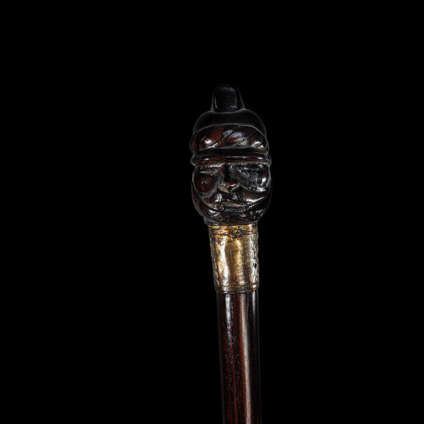 A Military Figure Rosewood Walking Stick Cane CIRCA. 19th CENTURY.