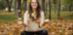 Canva - Woman Sitting on Fall Foliage(1)