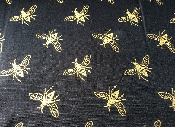 GOLD BEES ON A BLACK BACKGROUND