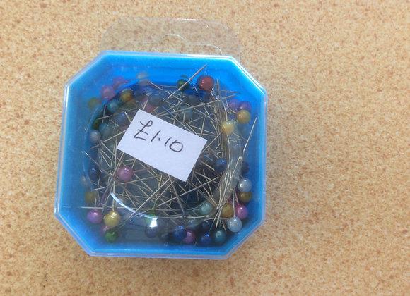 PINS IN OCTAGNAL BLUE BOX