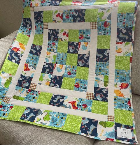 Andree s  quilt uing Dino and friends